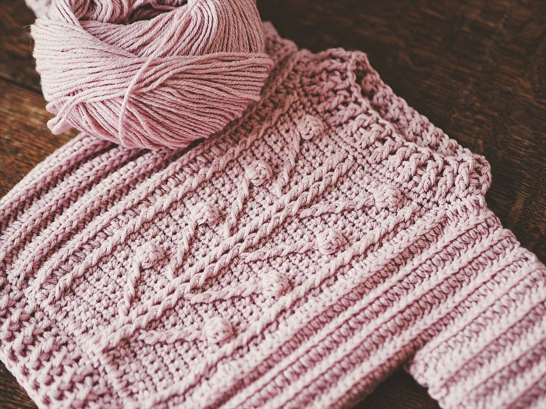 Image of a child's pink knit sweater